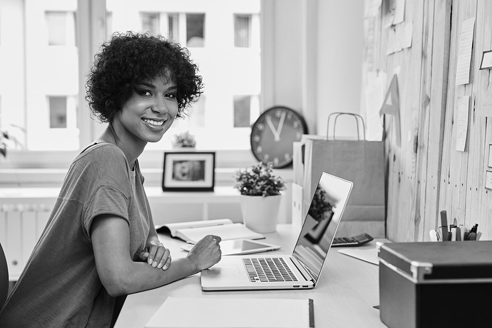 Young woman entrepreneur working from home