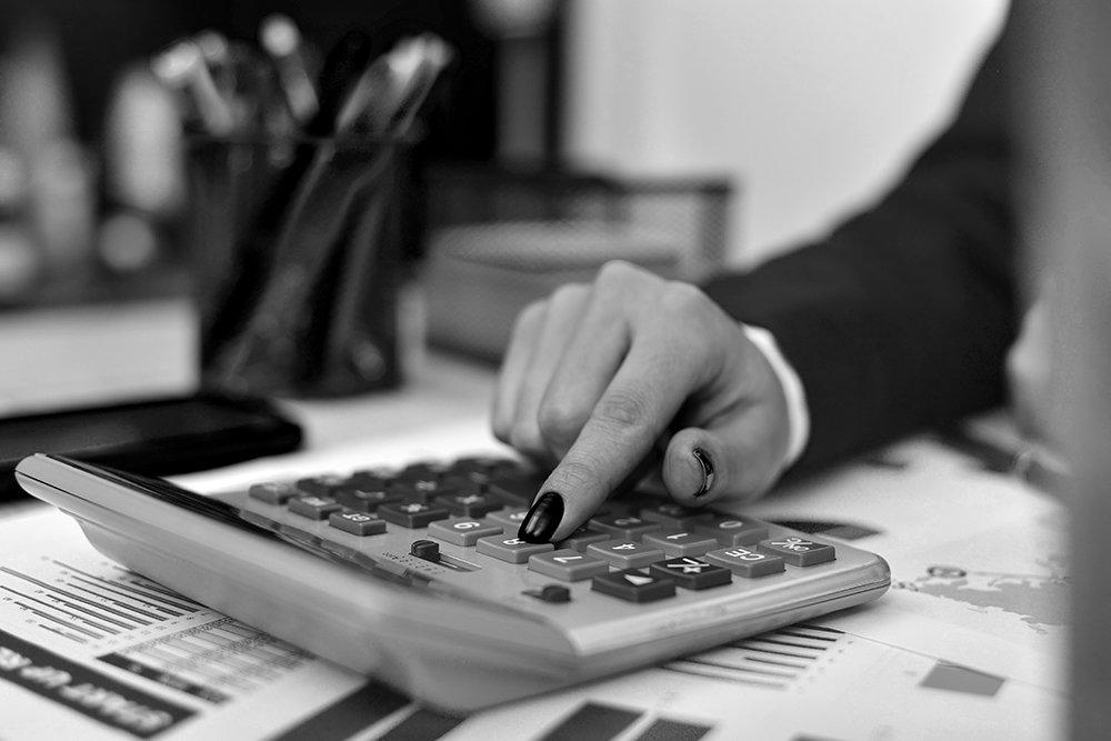 closeup of businesswoman's fingers using a calculator